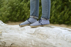 Women shoes and jeans and baulk Royalty Free Stock Images