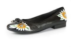 Women shoes with printed flower Stock Image