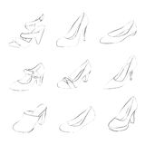 Women shoes silhouettes. Isolated on white background Stock Image