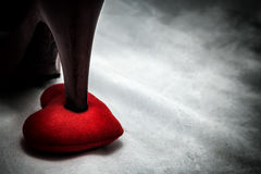 Women shoes stomp on broken heart in dark tone., unrequited love. Love concept for valentines day Royalty Free Stock Photos