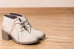 Women shoes on wooden floor copy space Stock Photos