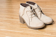 Women shoes on wooden floor Stock Photography