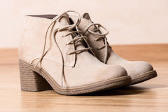 Women shoes on wooden floor horizontal Royalty Free Stock Photos