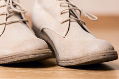 Women shoes on wooden floor macro Royalty Free Stock Photo