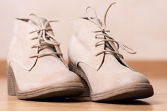 Women shoes on wooden floor shallow DOF Royalty Free Stock Photos
