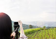Women shooting photo or video of landscape sky and mountain natu royalty free stock photo