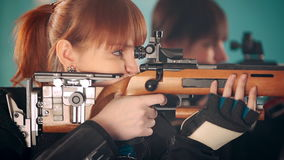 Women shooting with rifle stock video footage