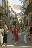 Women shop in old section of city of Sevilla, Andalucia, Southern Spain Stock Images