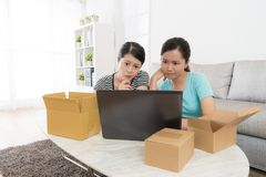 Women shopper looking at online shopping website. Attractive beauty women shopper looking at online shopping website at home and thinking buying which goods stock photography
