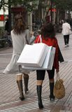Women shopping. Two women shopping in a city street Stock Photography