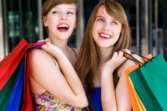 Women Shopping. Two women with shopping bags Royalty Free Stock Photography