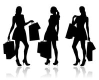 Women with shopping bags Stock Images