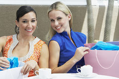 Women With Shopping Bags At Cafe Stock Image