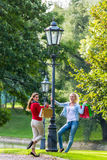 Women with shopping bags on city light lantern Stock Image