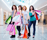 Women with shopping bags at shop Royalty Free Stock Images