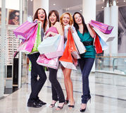 Women with shopping bags at shop Royalty Free Stock Photography