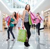 Women with shopping bags at shop Royalty Free Stock Image