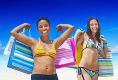 Women with shopping bags on a tropical beach Stock Images