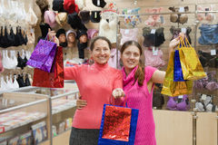 Women with shopping bags  in underwear shop Stock Photography