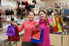 Women with shopping bags in underwear shop Royalty Free Stock Photography