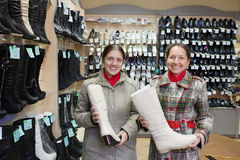 Women shopping boots at  shoe Stock Images