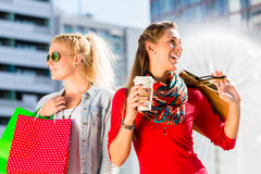 Women shopping in city with bags Stock Photos