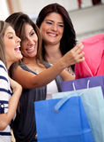 Women shopping for clothes Royalty Free Stock Photos