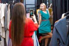 Women shopping clothes Stock Image