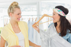 Women shopping in clothes store Royalty Free Stock Photo
