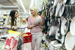 Women shopping cookware Royalty Free Stock Photos