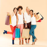 Women Shopping. Four different women sharing the passion for shopping Royalty Free Stock Image
