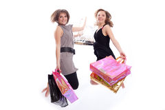 Women shopping and jumping in white. Shopper: Two women jumping with shopping's bags in a white background Royalty Free Stock Photography
