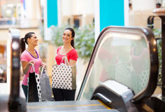 Women in shopping mall. Two happy young women in shopping mall Royalty Free Stock Images