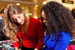 Women in a shopping mall with clothes Royalty Free Stock Photography