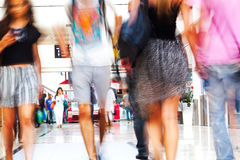 Women in a shopping mall. Women on the move in a shopping mall in motion blur Royalty Free Stock Photo