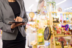 Women in shopping mall using mobile Tablet PC. Stock Photography