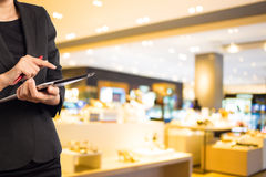 Women in shopping mall using mobile Tablet PC. Royalty Free Stock Photo