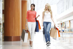 Women shopping in mall Royalty Free Stock Image