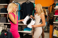 Women in shopping for  man Stock Images