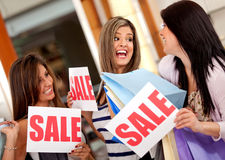 Women on shopping sale Stock Images