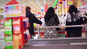 Women shopping at the supermarket. 1920x1080 stock video
