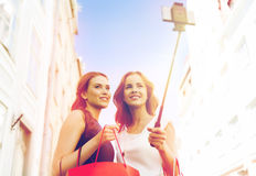 Women shopping and taking selfie by smartphone Royalty Free Stock Photo