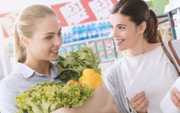 Women shopping together at the supermarket Stock Photo