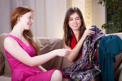 Women after shopping. Two women after shopping watching their clothes Stock Image