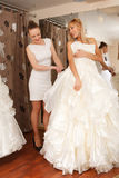Women Shopping For Wedding Dress Royalty Free Stock Images