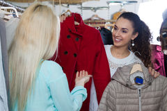 Women shopping winter outwear Stock Images