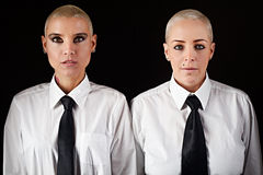 Women with short hair wearing mens clothes Royalty Free Stock Photography