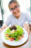 Women show fresh salad Stock Images