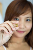 Women show the pill for healthy Stock Images