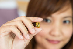 Women show the pill for healthy in horizontal Royalty Free Stock Photo